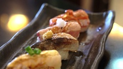 Aburi nigiri set or seared sushi set. Japanese food, fish with fast fire burn Stock Footage