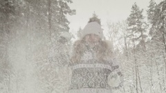 Winter forest. Girl playing in the snow, happy and laughing. Stock Footage