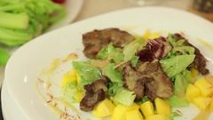 Salad with chicken liver and mango Stock Footage