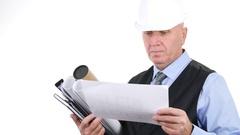 Elegant Engineer Wearing Black Jacket and White Helmet Analyzing Building Plans. Stock Footage