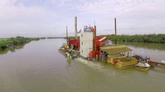 An extraction platform navigates in a river. Africa, Mali. About industry Stock Footage