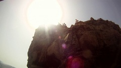 POV of two young men jumping off a cliff and doing a backflip in Malta. Stock Footage