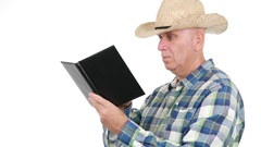 Farm Worker with Cowboy Hat  Note in Agenda Important Agricultural Information. Stock Footage