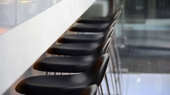 Barstools lined up at a modern bar in a hotel. Stock Footage