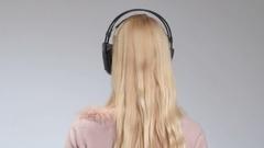 Emotional girl in headphones listening music Stock Footage