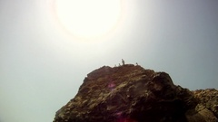 POV of a young man jumping off a cliff in Malta. Stock Footage