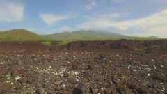 Aerial Tropical Jungle Mountians Maui Fly Over Lava Rocks to Green Mountians Stock Footage