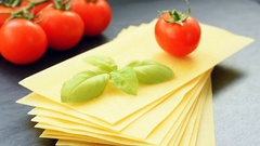 Gluten free vegan lasagna with cherry and basil Stock Footage