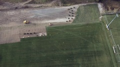Machinery Working on the Laying of an Artificial Soccer Field Stock Footage