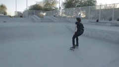 A young man in-line-skating at a skatepark. Stock Footage