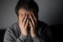 Portrait of thoughtful sad man Stock Photos