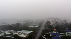 Heavy rain in tropical city. High angle view Stock Footage