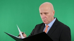 Serious Businessman Read and Write Data in One Technical Documents Folder. Stock Footage