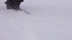 Man running in deep snow on winter day Stock Footage