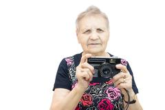 Pensioner with a camera Stock Photos