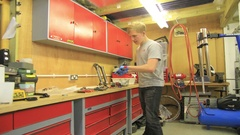 Time-lapse of a man working on his mountain bike in a workshop, time-lapse. Stock Footage