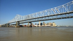 Tilt down to twin span brigde and French New Orleans Louisiana skyline Stock Footage