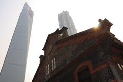 Old, traditional versus modern architecture buildings at Shanghai boom Stock Photos