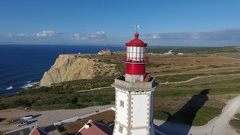 Lighthouse rocky coastline near cape espichel Sesimbra Portugal aerial shot 4k Stock Footage