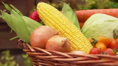 Still life with corn, tomatoes, potatoes and onions in the basket Stock Footage