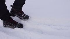 Walking in winter snow Stock Footage