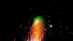 Fireworks display beautiful large fireworks fire sparks moving up green 4k Stock Footage