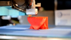 3d printer printing small object closeup by layering ink jet printing technology Stock Footage
