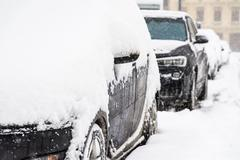 Cars Covered With Fresh White Snow After A Heavy Blizzard In Bucharest City Stock Photos