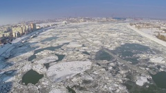 Aerial view of Tulcea city harbor and the Danube covered in ice floes Stock Footage