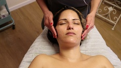 Hot Stone Therapy for the Face Stock Footage