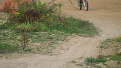 A man riding his motocross motorcycle. Stock Footage