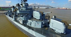 USS Kidd on mississippi river in baton rouge louisiana aerial drone Stock Footage