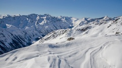 Sunny Winter Day in Snowy Alps Mountain Time Lapse. Dolly Shot over Snowdrift Stock Footage