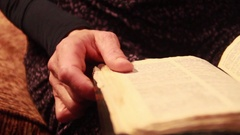 Close-up of a woman reading a bible and highlighting words. Stock Footage