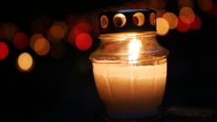 Candles Burning At a Cemetery During All Saints Day. Shallow depth of field Stock Footage