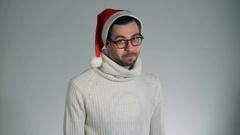 Amazing man in a Santa Claus hat danced crazy dances Stock Footage