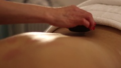Hot Stones used during massage Stock Footage