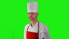 Handsome adult chef turns, he crosses his arms and nods his head close-up on a Stock Footage