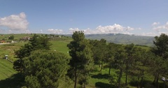 4k drone landscape shot above landscape at summer in Italy with mountains Stock Footage