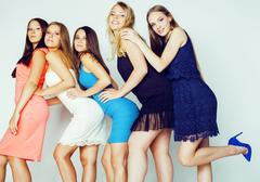 Group of many cool modern girls in bright clothers together having fun isolated Stock Photos