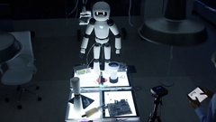 4K Electronics engineer working on design of robot in dark lab Stock Footage