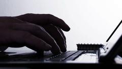 Hackers hands typing on laptop keyboard - 4k Stock Footage