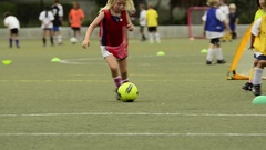 Children ages 5-7 playing soccer/ football. Stock Footage