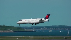 Delta Airlines small plane landing airport runway Stock Footage