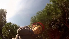 POV of a boy riding a scooter at a park crashes. Stock Footage
