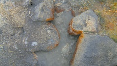 Amazing bright blue and yellow stones and boiling mud in geothermal area in Stock Footage
