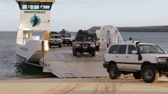 4x4 disembarking Mantaray barge vehicle ferry to Fraser Island Stock Footage