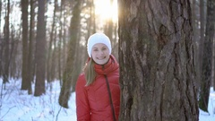 Beautiful young woman in the winter park, having fun, smiling. Slow motion video Stock Footage