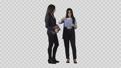 Two women in business clothes are standing and watching documents Stock Footage