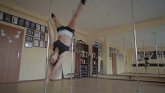 Beautiful young girl Pole dance studio stock footage video Stock Footage